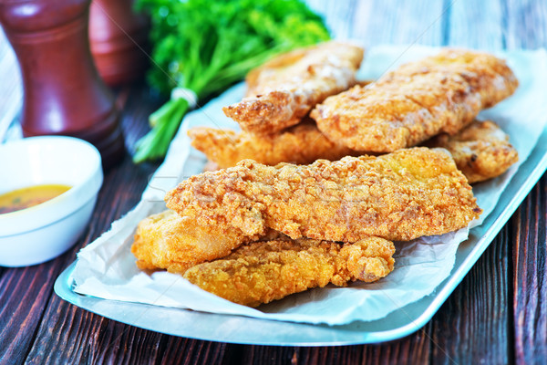 Сток-фото: жареный · рыбы · лоток · таблице · фон · ресторан