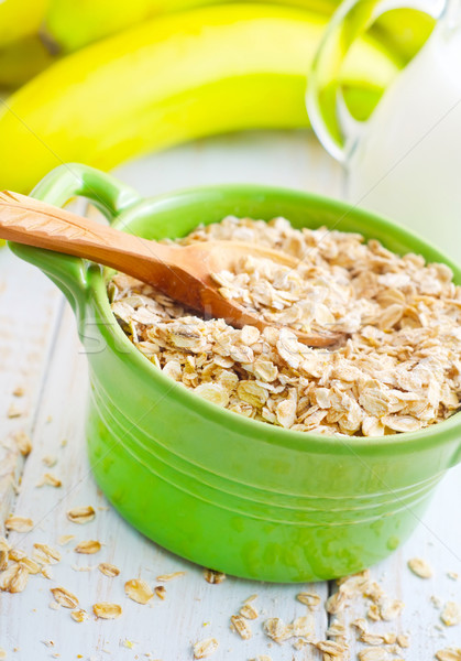 Zab pelyhek zöld tál banán tej Stock fotó © tycoon