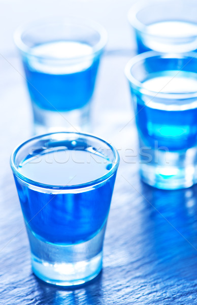 blue alcoholic drink into small glasses Stock photo © tycoon