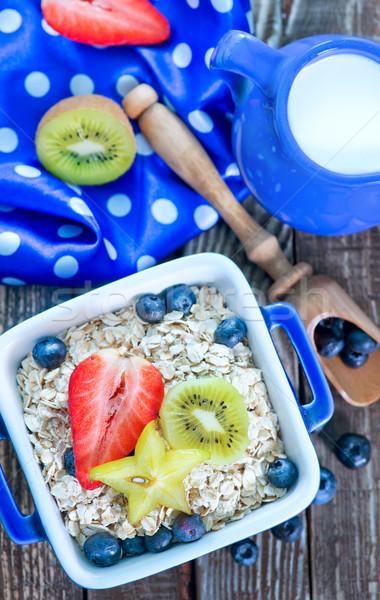Kahvaltı yulaf meyve karpuzu çanak Stok fotoğraf © tycoon