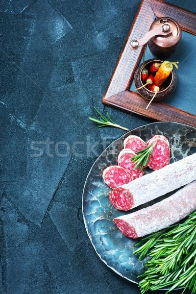 Salami épices bord alimentaire fond Photo stock © tycoon