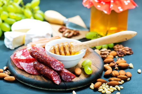 Antipasti fehér tányér asztal piros hús Stock fotó © tycoon