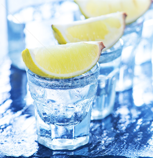 tequilla with limes Stock photo © tycoon