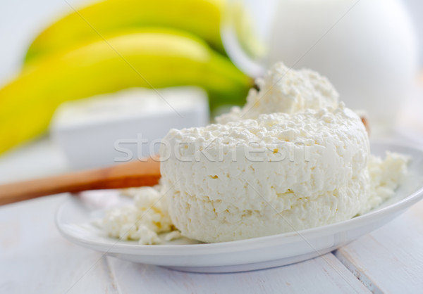 Milk products, fresh cottage in the white plate Stock photo © tycoon