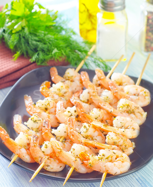 boiled shrimps are beaded on sticks Stock photo © tycoon
