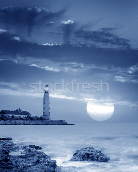 Faro playa agua edificio puesta de sol luz Foto stock © tycoon