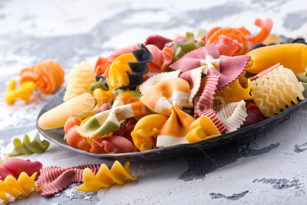 Crudo pasta placa mesa fondo color Foto stock © tycoon