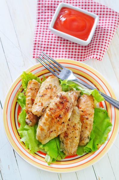 Tavuk kızartma kanatlar arka plan tavuk akşam yemeği plaka Stok fotoğraf © tycoon