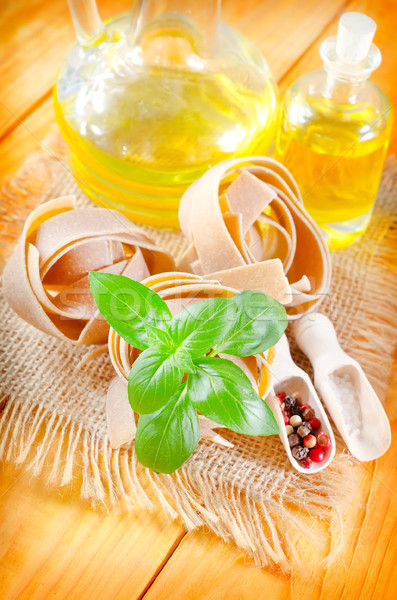 Raw pasta with aroma spice and basil Stock photo © tycoon