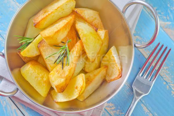 Sült krumpli forró vasaló edény hagyma Stock fotó © tycoon