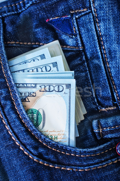 dollars in jeans pocket Stock photo © tycoon