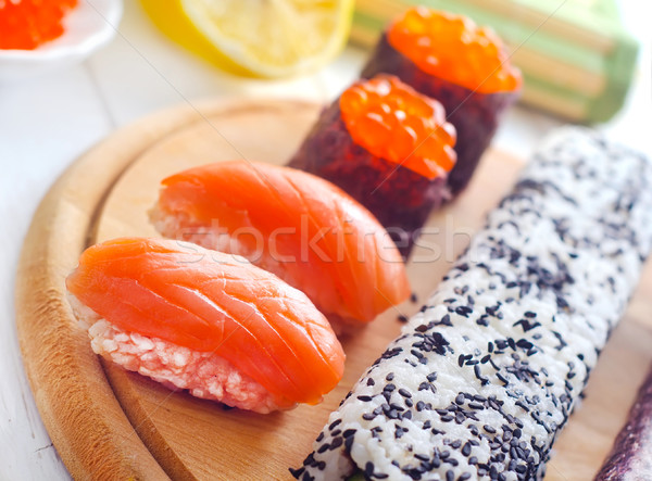 Fresh rolls and sushi with salmon Stock photo © tycoon