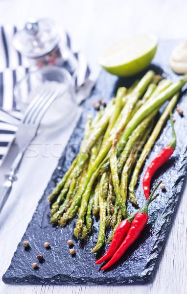 Kuşkonmaz baharat siyah taş tahta Stok fotoğraf © tycoon