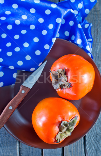 Ripe persimmons  Stock photo © tycoon