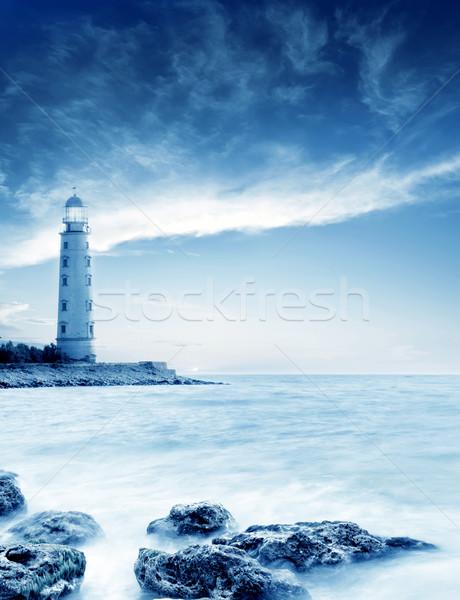 Phare ciel eau coucher du soleil paysage lumière Photo stock © tycoon