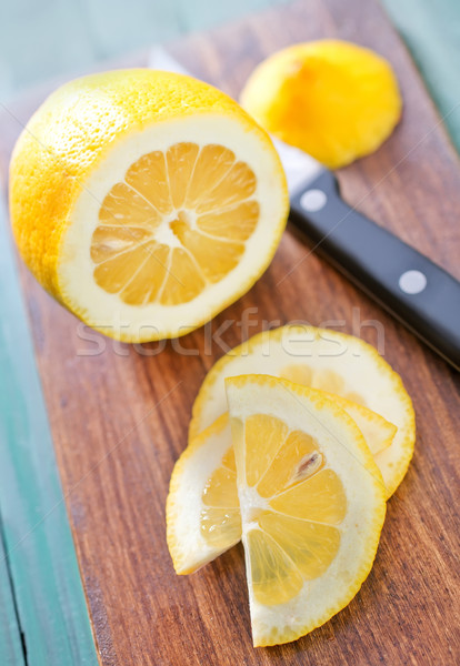 Citron bord alimentaire bois orange table Photo stock © tycoon