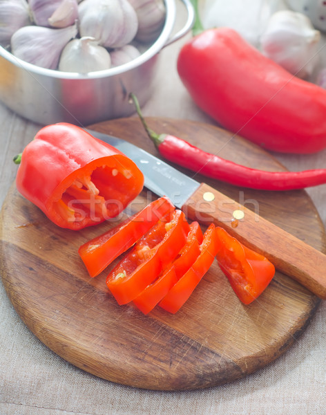Raw red peppers on the wooden board Stock photo © tycoon