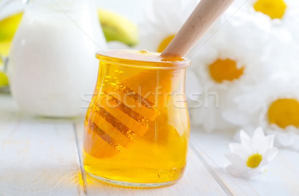 Frescos miel vidrio banco madera Foto stock © tycoon