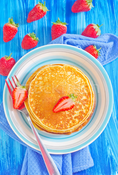 pancakes on plate and fresh strawberries Stock photo © tycoon