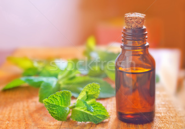 Aroma olaj virágok levél zöld üveg Stock fotó © tycoon