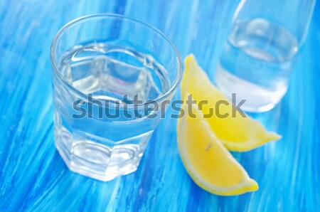 water with lemons Stock photo © tycoon