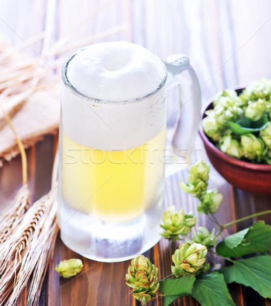 Cerveza vidrio mesa de madera luz mesa bar Foto stock © tycoon
