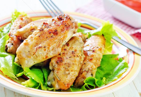 жареная курица крыльями фон куриные обеда пластина Сток-фото © tycoon