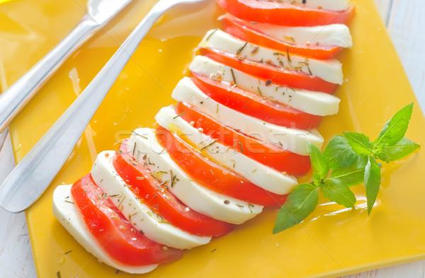 Caprese frescos ensalada tomate mozzarella hoja Foto stock © tycoon