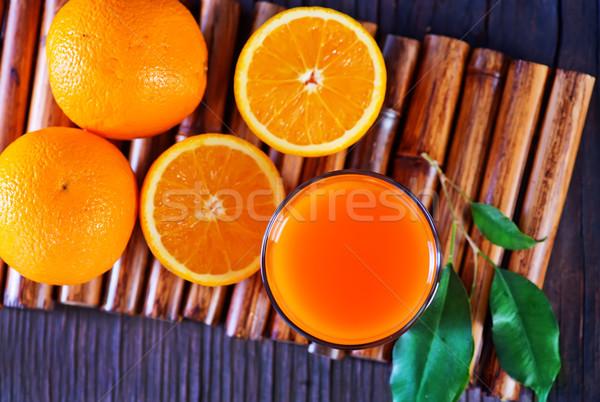 Sinaasappelsap glas tabel hout vruchten keuken Stockfoto © tycoon