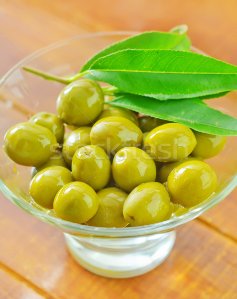 green olives and oil Stock photo © tycoon