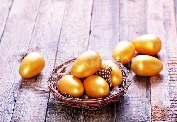 Paskalya yumurtası altın yumurta yuva tablo iş Stok fotoğraf © tycoon