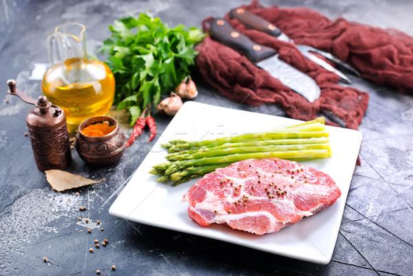 Carne asparagi greggio bianco piatto nero Foto d'archivio © tycoon
