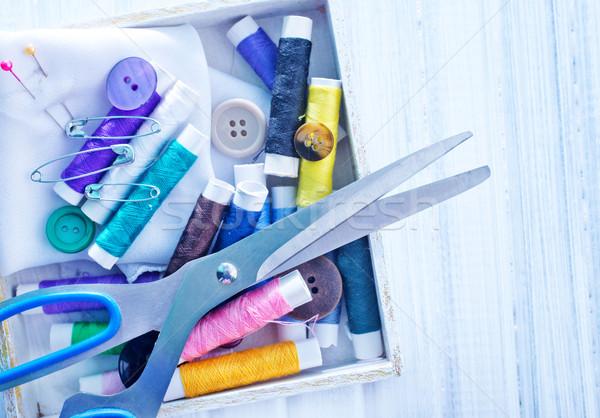 Scissors, bobbins with thread and needles Stock photo © tycoon