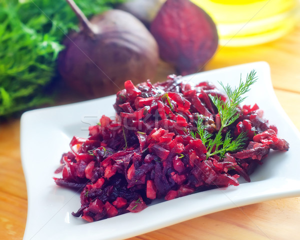 Fresh salad with beet and walnuts on white plate Stock photo © tycoon