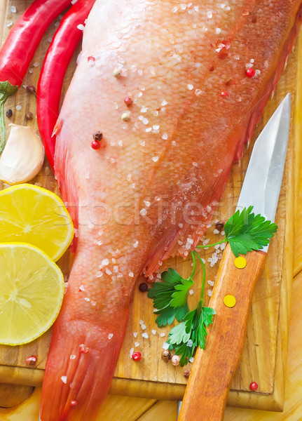 raw fish with aroma spice on wooden background Stock photo © tycoon