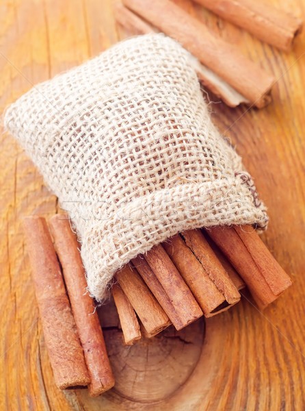 Aroma cinnamon sticks on the wooden board Stock photo © tycoon