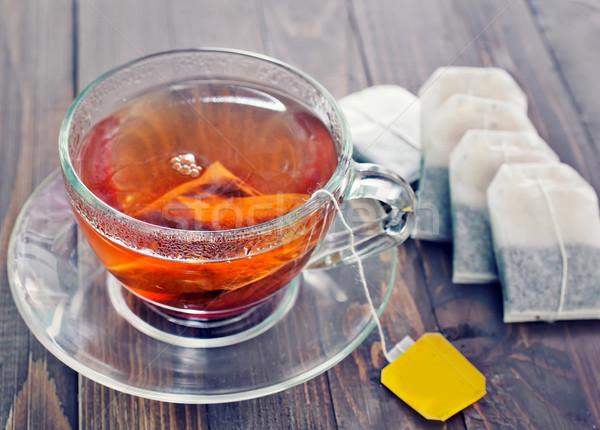 Stok fotoğraf: çay · cam · fincan · ahşap · masa · arka · plan