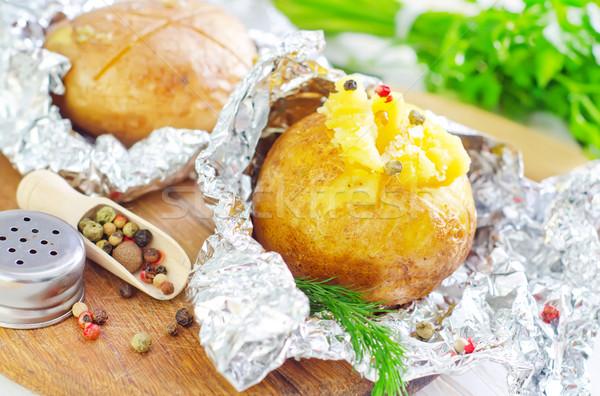 baked potato in foil Stock photo © tycoon