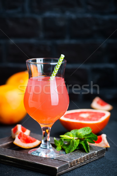 Pamplemousse jus verre table eau fruits Photo stock © tycoon