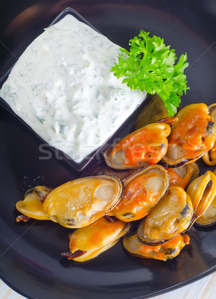 Stock photo: mussels with sauce