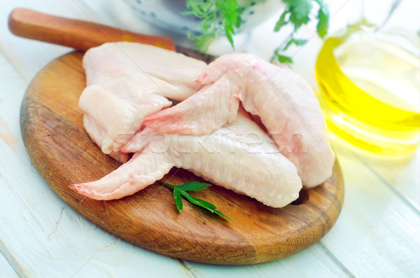 Raw chicken and knife on the wooden board Stock photo © tycoon