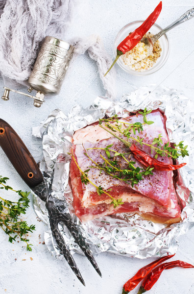 Stock photo: raw meat in foil