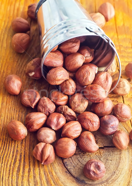 Nuts on the wooden board Stock photo © tycoon