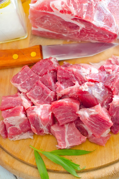 raw meat and knife on the wooden board Stock photo © tycoon