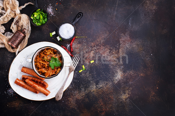 Salsichas repolho frito tigela tabela fogo Foto stock © tycoon