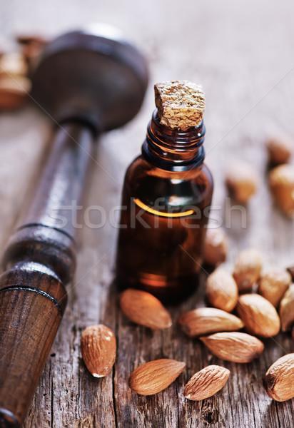 Photo stock: Amande · pétrolières · verre · bouteille · ensemble · noix