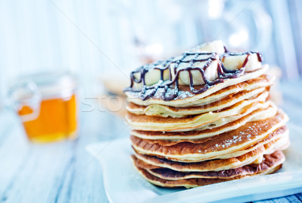 pancakes with banana and chocolate Stock photo © tycoon