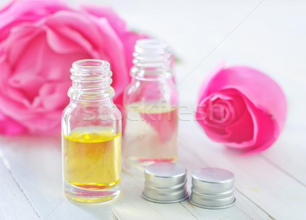 Gül yağ çiçek cam güzellik şişe Stok fotoğraf © tycoon