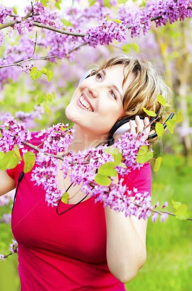 woman with headphones Stock photo © tycoon