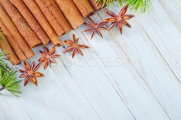 Сток-фото: корицей · анис · фрукты · фон · оранжевый · звездой